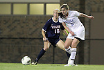 29 September 2011: Duke's Kelly Cobb (9) shoots the ball past Virginia's Maggie Kistner (16). The Duke University Blue Devils and the University of Virginia Cavaliers played to a 0-0 tie after overtime at Koskinen Stadium in Durham, North Carolina in an NCAA Division I Women's Soccer game.