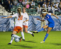 Number one seed Virginia and number two seed UCLA play in the the NCAA Division I Soccer Tournament semifinals at Wakemed Soccer Park in Cary, NC on December 6, 2013.  Ally Courtnall (42) shoots and scores the tying goal to send the game into overtime.
