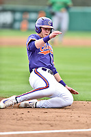 Clemson Tigers left fielder Seth Beer (28) slides into third base during a game against the Notre Dame Fighting Irish at Doug Kingsmore Stadium on March 11, 2017 in Clemson, South Carolina. The Tigers defeated the Fighting Irish 6-5. (Tony Farlow/Four Seam Images)
