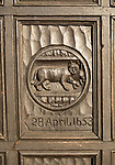Historic carved wooden panel on door of house in Marlborough, Wiltshire, England, UK commemorates the Great Fire of 1653