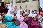 Palestinians wear a traditional costumes, attend a festival marking Traditional Palestinian Dress Day, in the West Bank city of Nablus on August 22, 2017. Photo by Ayman Ameen