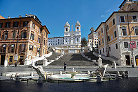 Spanish steps empty and patrolled by police<br /> Rome March 12th 2020. Rome the day after the last Coronavirus decree, that increase the restrictions of the march 9th decree. All the shops, bars, restaurants and pubs will have to stay close, apart for the ones of public utility as pharmacies, supermarkets and tobacco stores. People are requested to stay at home and go out just to buy food or medicines. In city centre, police officers warn the few tourists and passers to stay into the hotels or at home and to get out just to find food. <br /> Photo Samantha Zucchi Insidefoto