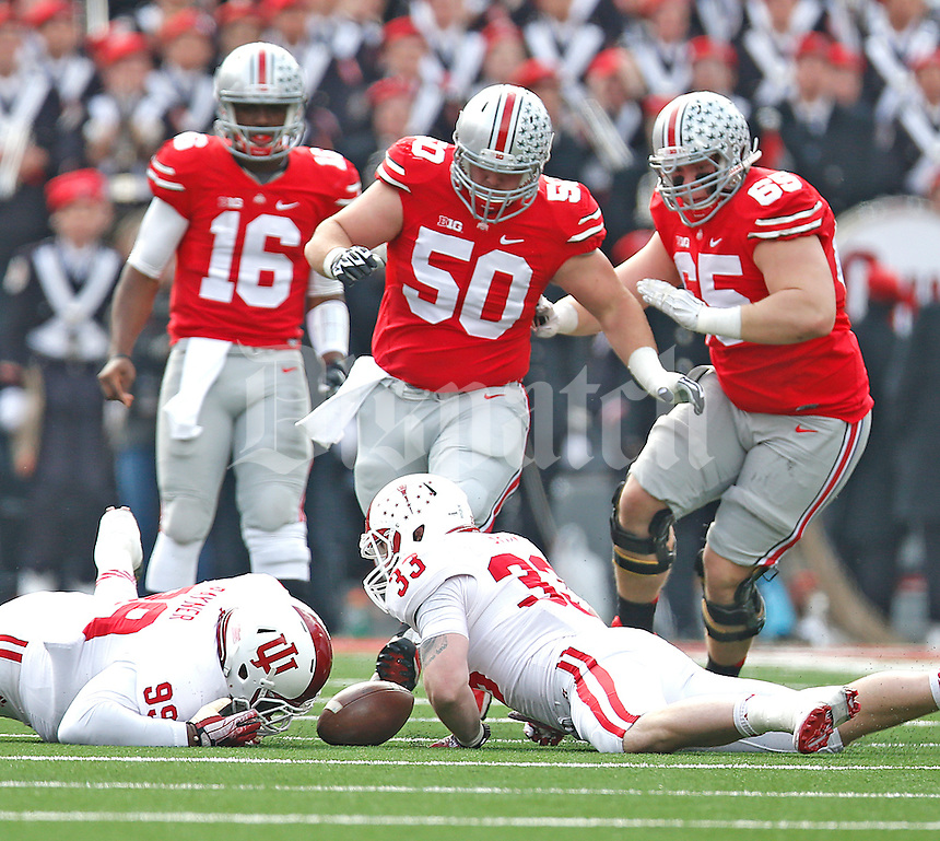 Indiana Hoosiers defensive end Zack Shaw (33) picks up a first quarter fumble at Ohio Stadium on 22, 2014. (Chris Russell/Dispatch Photo)