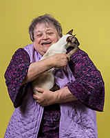 June Colwell of Mira Loma, Calif. holds her Chocolate Point Siamese named Little Sis at the 44th East of Eden Cat Fancier's in Monterey, Calif. on Feb. 22, 2020.