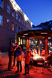 USA, Colorado, Aspen, people warm up by the fire in the sqare in downtown Aspen at dusk