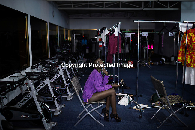 KINSHASA, DRC - JULY 18: A model waits backstage for a show to start at Kinshasa Fashion Week on July 18, 2014, at Shark club in Kinshasa, DRC. Local and invited foreign-based designers showed their collections during the second edition of Kinshasa Fashion week. (Photo by Per-Anders Pettersson)
