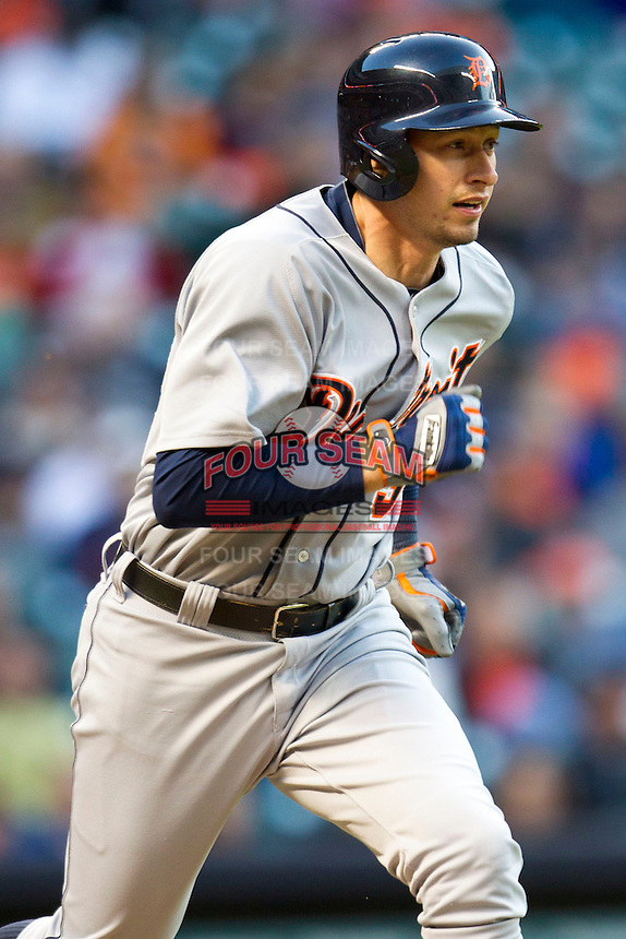 Detroit Tigers outfielder Don Kelly (32) runs to first base during the MLB baseball game against the Houston Astros on May 3, 2013 at Minute Maid Park in Houston, Texas. Detroit defeated Houston 4-3. (Andrew Woolley/Four Seam Images).