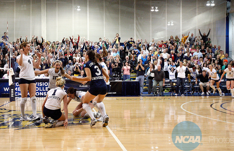 05 DEC 2009: Concordia University players celebrate after beating West Texas A&M University during the Division II Women's Volleyball Championship held at the Gangelhoff Center on the campus of Concordia University in St. Paul, MN.  Concordia defeated West Texas A&M 3-0 for the national title.  Carlos Gonzalez/NCAA Photos