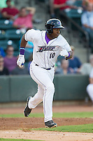 Courtney Hawkins (10) of the Winston-Salem Dash hustles down the first base line against the Carolina Mudcats at BB&T Ballpark on June 6, 2014 in Winston-Salem, North Carolina.  The Mudcats defeated the Dash 3-1.  (Brian Westerholt/Four Seam Images)