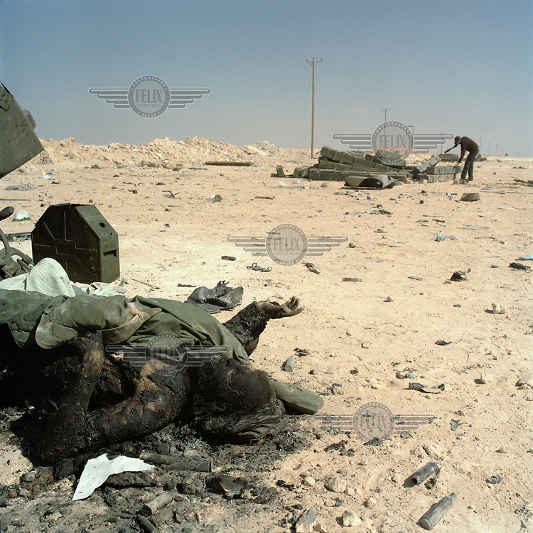 The burnt body of a loyalist soldier killed in a NATO airstrike on the western outskirts of Ajdabiya. On 17 February 2011 Libya saw the beginnings of a revolution against the 41 year regime of Col Muammar Gaddafi.