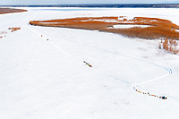 Two teams rest during their run up the Yukon River between the Grayling and Eagle Island checkpoints as two snowmachines travel by on Saturday, March 10th during the 2018 Iditarod Sled Dog Race -- Alaska<br /> <br /> Photo by Jeff Schultz/SchultzPhoto.com  (C) 2018  ALL RIGHTS RESERVED