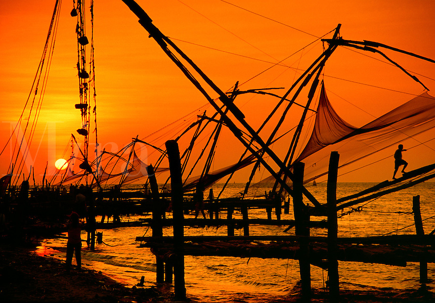Chinese fishing nets at sunset Cochin Kerala State India