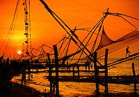 Chinese fishing nets at sunset Cochin Kerala State India