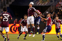 Colorado Rapids forward Caleb Folan (21) gets his head on a ball battling with CD Chiave USA midfielder Michael Lahoud (11). The Colorado Rapids defeated CD Chivas USA 1-0 at Home Depot Center stadium in Carson, California on Saturday March 26, 2011...