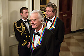 Jimmy Page (L) and Robert Plant of the band Led Zeppelin attend the Kennedy Center Honors reception at the White House on December 2, 2012 in Washington, DC. The Kennedy Center Honors recognized seven individuals - Buddy Guy, Dustin Hoffman, David Letterman, Natalia Makarova, John Paul Jones, Jimmy Page, and Robert Plant - for their lifetime contributions to American culture through the performing arts. .Credit: Brendan Hoffman / Pool via CNP