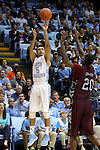 14 November 2014: North Carolina's Marcus Paige (5) shoots over NC Central's Jamal Ferguson (20). The University of North Carolina Tar Heels played the North Carolina Central University Eagles in an NCAA Division I Men's basketball game at the Dean E. Smith Center in Chapel Hill, North Carolina. UNC won the game 76-60.