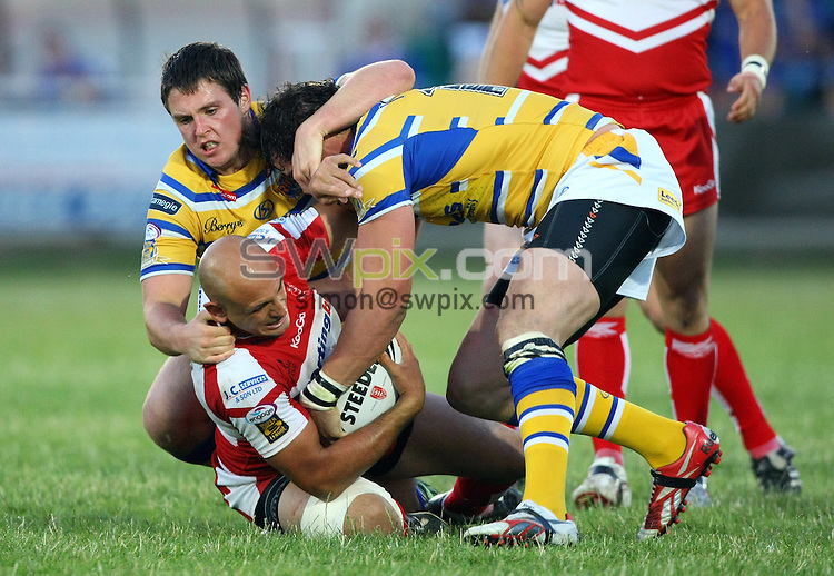 PICTURE BY VAUGHN RIDLEY/SWPIX.COM - Rugby League - Super League - Hull KR v Leeds - Craven Park, Hull, England - 09/07/10...Copyright - Simon Wilkinson - 07811267706...Leeds Luke Ambler and Ian Kirke tackle Hull KR's Mick Vella.