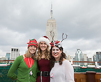 NEW YORK, NY - December 10: Revelers dressed as Santa Claus on the roof top of a bar during the annual SantaCon event in New York City , December 10, 2016.VIEWpress/Maite H. Mateo
