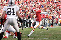 Chiefs kicker Lawrence Tynes kicks an extra point in the fourth quarter against the Oakland Raiders at Arrowhead Stadium in Kansas City, Missouri on November 19, 2006. The Chiefs won 17-13.