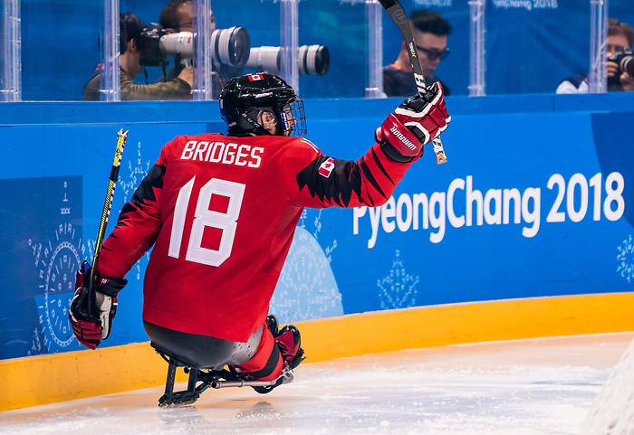 PyeongChang 15/3/2018 - Billy Bridges (#18), of Summerside, PEI, celebrates his goal as Canada takes on Korea in semifinal hockey action at the Gangneung Hockey Centre during the 2018 Winter Paralympic Games in Pyeongchang, Korea. Photo: Dave Holland/Canadian Paralympic Committee