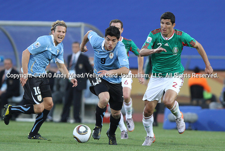 22 JUN 2010: Luis Suarez (URU) (9) is chased by Francisco Rodriguez (MEX) (2). The Mexico National Team lost 1-2 to the Uruguay National Team at Royal Bafokeng Stadium in Rustenburg, South Africa in a 2010 FIFA World Cup Group A match.