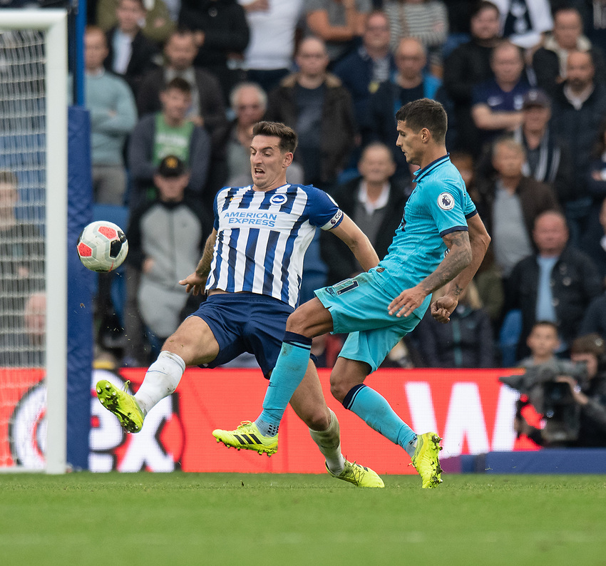 Brighton & Hove Albion's Lewis Dunk (left) battles for possession with Tottenham Hotspur's Erik Lamela (right) <br /> <br /> Photographer David Horton/CameraSport<br /> <br /> The Premier League - Brighton and Hove Albion v Tottenham Hotspur - Saturday 5th October 2019 - The Amex Stadium - Brighton<br /> <br /> World Copyright © 2019 CameraSport. All rights reserved. 43 Linden Ave. Countesthorpe. Leicester. England. LE8 5PG - Tel: +44 (0) 116 277 4147 - admin@camerasport.com - www.camerasport.com