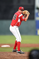 Batavia Muckdogs pitcher Christian MacDonald (39) gets ready to deliver a pitch during a game against the State College Spikes on July 3, 2014 at Dwyer Stadium in Batavia, New York.  State College defeated Batavia 7-1.  (Mike Janes/Four Seam Images)