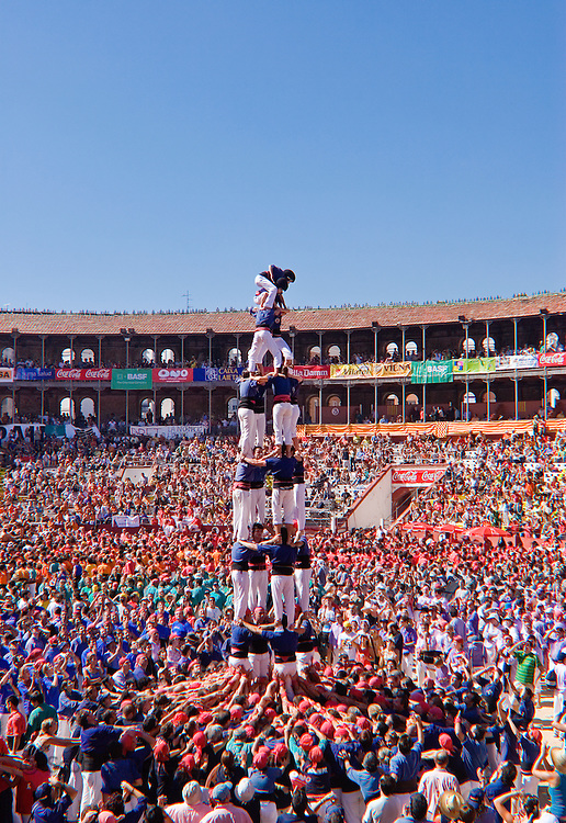 The castellers, or traditional human castle-builders, of Catalonia are an incredible sight to behold: Using only the bodies of their teammates, these groups of men, women and children climb quickly and intently upwards -- grasping hips with hands, digging bare feet into the crooks of knees and folds of cummerbunds, hoisting their full weight up to stand on the shoulders of the person above them -- to construct soaring, heart-stopping human towers of nine to 10 levels high. They perform from June to November in various towns and cities of Catalonia, including Barcelona.