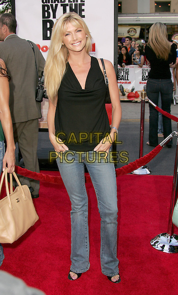 "BRANDE RODERICK.The World Premiere of ""Dodgeball:A True Underdog Story"", Westwood, California.June 14th, 2004.full length, full-length, jeans, denim, hands in pockets, black top.www.capitalpictures.com.sales@capitalpictures.com.©Capital Pictures"
