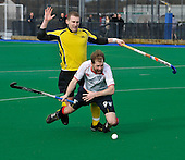 Hockey - Scottish Cup semi-finals at Peffermill - Edinburgh - Kelburne V Western Wildcats - Kelburne midfielder Michael Christie brings down Wildcats forward Douglas Simpson in the D - Kelburne won 4-0 - Picture by Donald MacLeod  1.4.12  07702 319 738  clanmacleod@btinternet.com