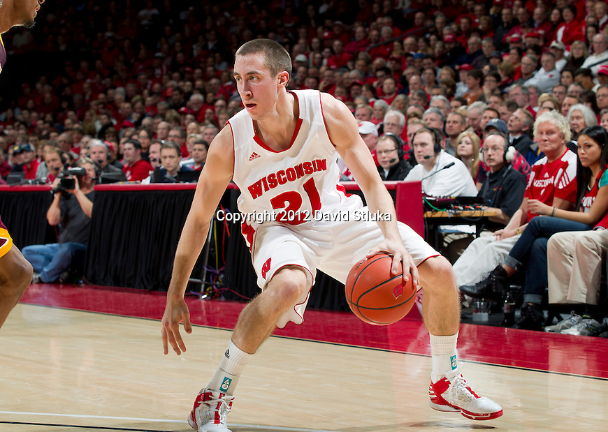 Wisconsin Badgers guard Josh Gasser (21) handles the ball during a Big Ten Conference NCAA college basketball game against the Minnesota Golden Gophers on Tuesday, February 28, 2012 in Madison, Wisconsin. The Badgers won 52-45. (Photo by David Stluka)