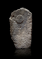 Late European Neolithic prehistoric Menhir standing stone with carvings on its face side.  Menhir Museum, Museo della Statuaria Prehistorica in Sardegna, Museum of Prehoistoric Sardinian Statues, Palazzo Aymerich, Laconi, Sardinia, Italy. Black background.