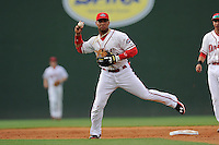 Second baseman Yoan Moncada (24) of the Greenville Drive throws out a runner in a game against the Lexington Legends on Monday, May 18, 2015, at Fluor Field at the West End in Greenville, South Carolina. Moncada, a 19-year-old prospect from Cuba, made his professional debut tonight in the Red Sox organization. (Tom Priddy/Four Seam Images)