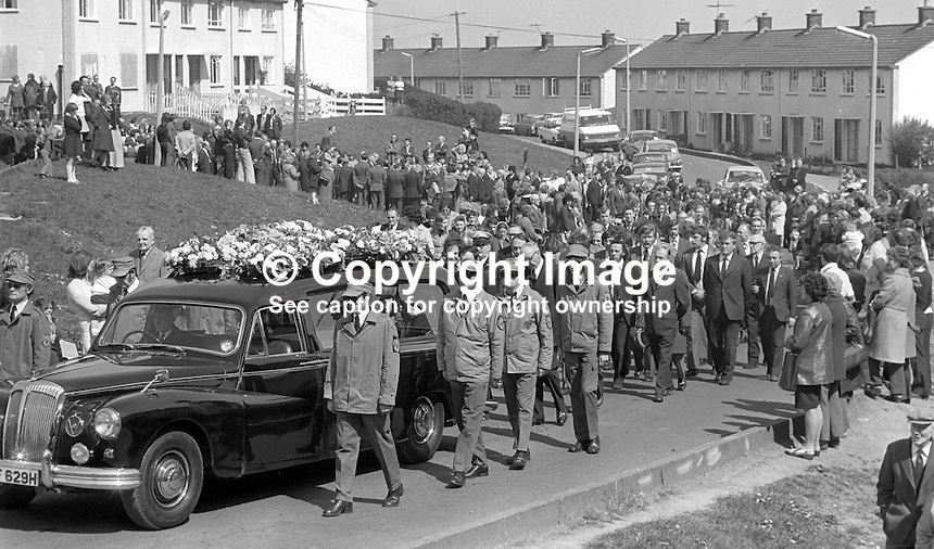 The funeral of murdered Citybus inspector, Alexander Millar, described as a captain in the UDA, Ulster Defence Association, departs from his home in North Belfast, N Ireland, UK. The hearse is flanked by para-military uniformed members of that organisation. Mr Millar was shot dead in his office At Ardoyne Bus Station after he was singled out by a gunman and an associate on 2nd May 1975. Although a UDA member would have been an obvious target for the Provisional IRA no claim or counter-claim was made to this effect. 197505020295b<br /> <br /> Copyright Image from Victor Patterson, 54 Dorchester Park, Belfast, UK, BT9 6RJ<br /> <br /> t1: +44 28 9066 1296<br /> t2: +44 28 9002 2446<br /> m: +44 7802 353836<br /> <br /> e1: victorpatterson@me.com<br /> e2: victorpatterson@gmail.com<br /> <br /> www.victorpatterson.com<br /> <br /> IMPORTANT: Please see my Terms and Conditions of Use at www.victorpatterson.com