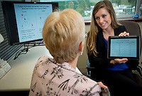 Kelly.Jordan@jacksonville.com--092112--Certified Genetic Counselor Maegan E. Roberts who is a counselor in Mayo Clinic Florida's Familial Cancer Program goes over a presentation she created to help her explain the complex details of genetic testing to her patients at Mayo Clinic Florida in Jacksonville Friday September 21, 2012.(The Florida Times-Union, Kelly Jordan)