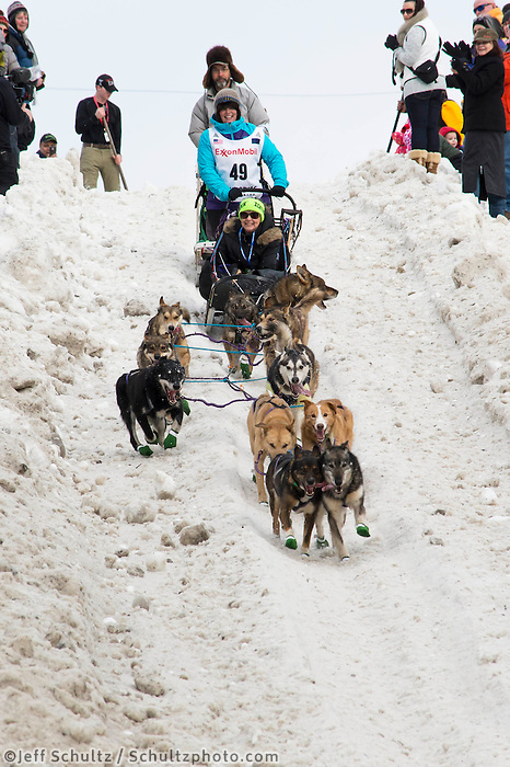 Mary Helwig and team run past spectators on the bike/ski trail with an Iditarider in the basket during the Anchorage, Alaska ceremonial start on Saturday, March 5, 2016 Iditarod Race. Photo by O'Hara Shipe/SchultzPhoto.com