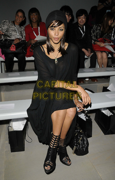 Ana Araujo.at the Felder Felder spring/summer 2012 catwalk show, London Fashion Week Day 1, BFC Catwalk Show Space, Somerset House, the Strand, London, England, UK, 16th September 2011..LFW full length sitting front row black dress long maxi kaftan hat turban cage shoes peep toe .CAP/CAN.©Can Nguyen/Capital Pictures.