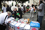 Signing petition, music and dancing. Protests are held in London every Saturday for democratic change in Zimbabwe. This set is from September 2007. Protests against Robert Mugabe, London, England