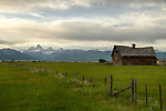 Idaho, Eastern, Driggs, A barn beneath the Teton Mountains in the Teton Valley in summer.