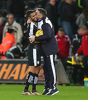 Riyad Mahrez of Leicester City gets a kiss from a member of the coaching staff as he is given the match ball at full time following his hattrick during the Barclays Premier League match between Swansea City and Leicester City played at The Liberty Stadium on 5th December 2015