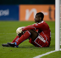 Bill Hamid (28) of D.C. United sits in front of the goal after being scored on at RFK Stadium in Washington, DC.  The Colorado Rapids defeated D.C. United, 1-0.