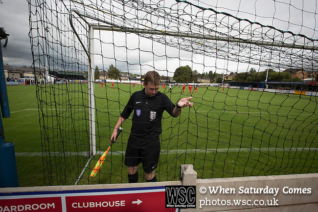 Clitheroe 0 Consett 1, 20/08/2016. Shawbridge, Northern Premier League Division One North. A referee's assistant checking the goal netting before Clitheroe (in blue) played Consett at Shawbridge in an FA Cup preliminary round tie. Northern Premier League division one north team Clitheroe were formed in 1877 and have played at the same ground since 1925. Visitors Consett, from the Northern League division one, won the match 1-0, watched by 207 spectators. Photo by Colin McPherson.