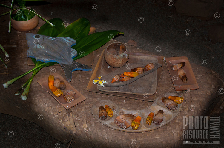 Examples of food, including hala keys, on a lauhala mat table at a recreated Hawaiian hut used as a men's eating house, Kamokila Hawaiian Village, Wailua River Valley, Kauai.