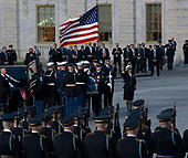 A military casket team carries casket of former President George. H. W. Bush to the Capitol Rotunda in Washington, DC where he will lie state, December 3, 2018. Credit: Chris Kleponis / CNP