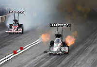 Mar 29, 2014; Las Vegas, NV, USA; NHRA top fuel dragster driver Antron Brown (right) against Steve Torrence during qualifying for the Summitracing.com Nationals at The Strip at Las Vegas Motor Speedway. Mandatory Credit: Mark J. Rebilas-USA TODAY Sports