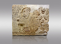 Picture &amp; image of Hittite relief sculpted orthostat stone panel  of Long Wall Limestone, Karkamıs, (Kargamıs), Carchemish (Karkemish), 900-700 BC. Anatolian Civilisations Museum.<br /> <br />  The hieroglyphics reads; &quot;I am Win-a-tis, beloved wife of my Lord Suhi, wherever and whenever my husband honours his name, he will honour my name as well with favours&quot;. Underneath, there are two goddess figures, one is naked with a horned head, holding her breasts with her hands. Her genitalia is indicated by a triangle. <br /> <br /> On a gray background.