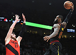 Cleveland Cavaliers forward LeBron James goes up for a dunk on Portland Trail Blazers center Jusuf Nurkic during the first half of an NBA basketball game in Portland, Ore., Thursday, March 15, 2018. (AP Photo/Steve Dykes)