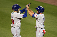 Round Rock Express first baseman Chad Tracy #28 greeted by Brian Barden #9 after a run during a game versus the Memphis Redbirds at Autozone Park on April 28, 2011 in Memphis, Tennessee.  Memphis defeated Round Rock by the score of 6-5 in ten innings.  Photo By Mike Janes/Four Seam Images
