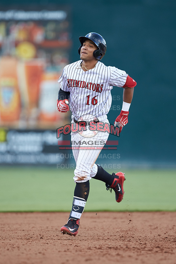Luis Curbelo (16) of the Kannapolis Intimidators rounds the bases after hitting a walk-off grand slam in the bottom of the eighth inning against the West Virginia Power at Kannapolis Intimidators Stadium on July 25, 2018 in Kannapolis, North Carolina. The Intimidators defeated the Power 6-2 in 8 innings in game one of a double-header. (Brian Westerholt/Four Seam Images)