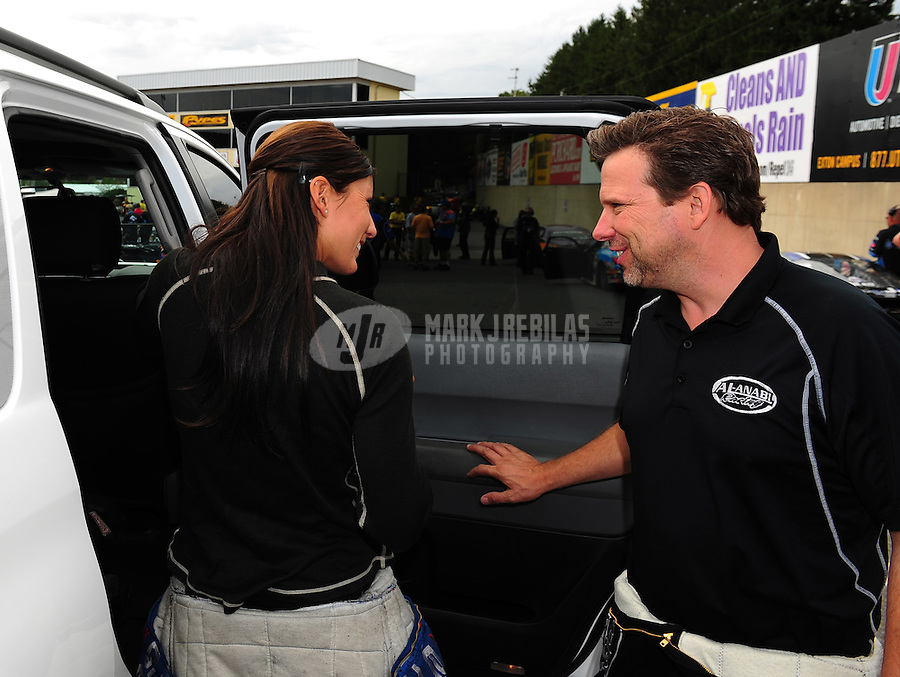 Sept. 30, 2011; Mohnton, PA, USA: NHRA funny car driver Leah Pruett (left) with top fuel dragster driver Del Worsham during qualifying for the Auto Plus Nationals at Maple Grove Raceway. Mandatory Credit: Mark J. Rebilas-